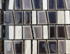 Mosaico grigio multiformato